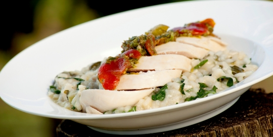 Lemon poached chicken with silverbeet risotto and herb dressing