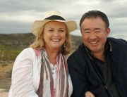 Lyndey with Tetsuya Wakuda on Prevelly Beach