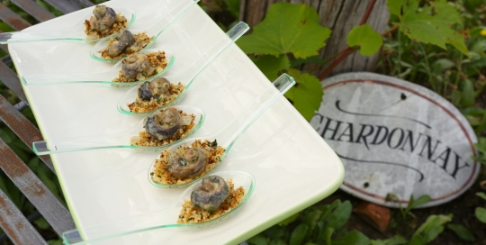 Snails in herbed cream sauce on garlic crumbs
